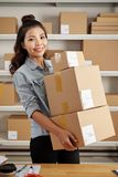 Pretty young woman working in warehouse royalty free stock photography