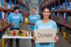 Portrait of happy volunteer holding sign boards with message Royalty Free Stock Photography