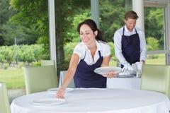 Portrait happy waiter and waitress standing in restaurant stock photos