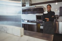 Portrait of happy waitress in cafe. Portrait of smiling young waitress standing in cafe Royalty Free Stock Photo