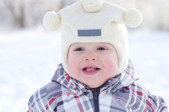 Portrait of happy warm dressed baby in winter Royalty Free Stock Images
