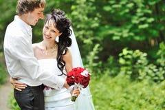 Portrait of happy wedding couple Stock Photos