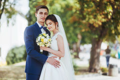 Portrait of happy wedding couple outdoors. Fantastic summer day Stock Photography