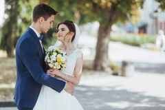 Portrait of happy wedding couple outdoors. Fantastic summer day Royalty Free Stock Photography