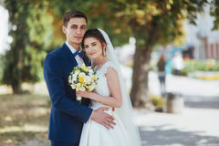 Portrait of happy wedding couple outdoors. Fantastic summer day Royalty Free Stock Photos