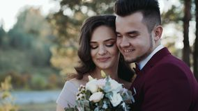 Portrait of happy wedding couple stands in embraces of each other stock video footage