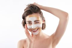 Portrait of happy winking female with face mask stock image