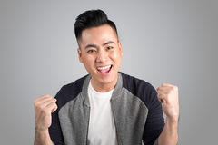 A portrait of happy winner young asian man with excited face. Royalty Free Stock Image