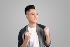 A portrait of happy winner young asian man with excited face. Royalty Free Stock Photography