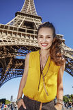 Portrait of happy woman against Eiffel tower in Paris, France Stock Images
