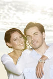 Portrait of happy woman with arm around man at beach Stock Images