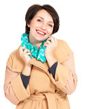 Portrait of happy woman in autumn coat with green scarf Royalty Free Stock Image