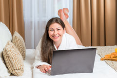 Portrait of happy woman in a bathrobe Stock Images