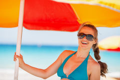 Portrait of happy woman on beach Stock Photos
