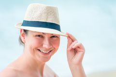 Portrait of a happy woman on the beach Stock Image