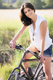 Portrait of an happy woman with bicycle Royalty Free Stock Images