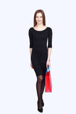 Portrait happy woman in black dress. With packs or bags Stock Image