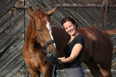 Portrait of happy woman and brown horse Royalty Free Stock Images