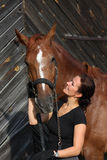Portrait of happy woman and brown horse Royalty Free Stock Photo
