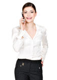Portrait of  happy woman calling by mobile  in white shirt Royalty Free Stock Photos