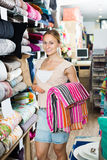 Portrait of happy woman choosing blanket. In bedding section in shop Royalty Free Stock Photo