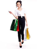 Portrait of happy woman with color shopping bags. Stock Photography