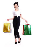 Portrait of happy woman with color shopping bags. Stock Photos