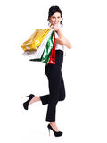 Portrait of happy woman with color shopping bags. Stock Images