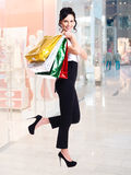 Portrait of happy woman with color shopping bags. Royalty Free Stock Photography