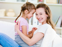 Portrait of happy woman with daughter Stock Images