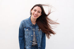 Happy woman in denim jacket with long hair blowing Stock Photo