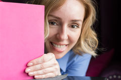 Portrait of a Happy Woman with a Diary Stock Photo