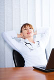 Portrait of happy woman doctor Stock Images