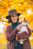 Portrait of happy woman dog outdoors in autumn Royalty Free Stock Photography