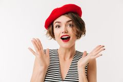 Portrait of a happy woman dressed in red beret. Screaming and looking at camera isolated over white background Royalty Free Stock Photography