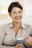 Portrait of happy woman drinking coffee Royalty Free Stock Photo