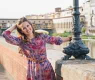 Portrait of happy woman on the embankment near Ponte Vecchio Stock Photo