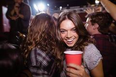 Portrait of happy woman enjoying music festival Royalty Free Stock Photos