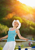 Portrait of happy woman enjoying vacation Stock Photos