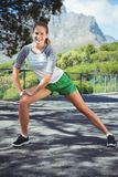 Portrait of happy woman exercising on road Royalty Free Stock Photo