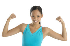 Portrait Of Happy Woman Flexing Her Muscles Royalty Free Stock Photo