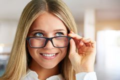 Woman with glasses in business center royalty free stock photography