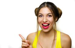 Portrait of a happy woman with hair chignons pointing finger awa royalty free stock images