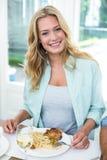 Portrait of happy woman having food Royalty Free Stock Photo