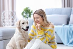 Portrait of happy woman with her dog. At home Stock Images