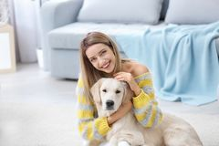 Portrait of happy woman with her dog. At home Royalty Free Stock Photos
