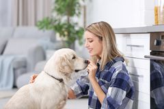 Portrait of happy woman with her dog. At home Stock Photo