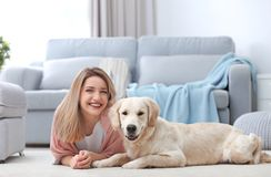 Portrait of happy woman with her dog. At home Royalty Free Stock Images