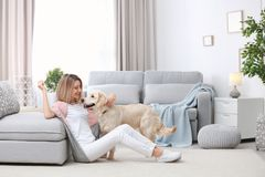 Portrait of happy woman with her dog. At home Royalty Free Stock Photo
