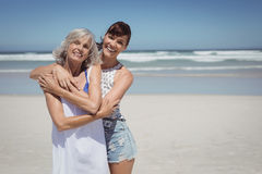 Portrait of happy woman with her mother standing at beach Stock Images